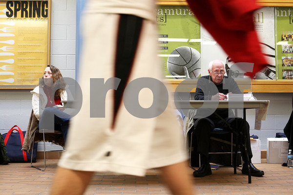 Rob Winner – rwinner@daily-chronicle.com<br /> Election judges Peggy Hernandez (left) and Jim Torma wait for voters at the NIU Student Recreation Center in DeKalb, Ill. on Tuesday February 2, 2010.