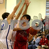 Rob Winner – rwinner@daily-chronicle.com<br /> Indian Creek's Seth Sanderson is pressured by a pair of Newark defenders during the fourth quarter in Somonauk, Ill. on Thursday February 4, 2010.