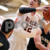 Beck Diefenbach - bdiefenbach@daily-chronicle.com<br /> <br /> DeKalb's Dylan Donnelly (12) shoots the ball during the first quarter of the IHSA Class 3A regional semifinal game against Sycamore at Kaneland High School in Maple Park, Ill., on Tuesday March 2, 2010.