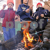 Kyle Bursaw – kbursaw@daily-chronicle.com<br /> <br /> Cub Scouts, from left, Andrew Geiger, Matthew reuscher and Gavin Fant roast some hot dogs over a fire in front of St. Mary's Church in Sycamore while waiting for people to come donate during their 'Camping for Cans' drive.<br /> <br /> Saturday, Nov. 27, 2010.