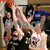 Beck Diefenbach - bdiefenbach@daily-chronicle.com<br /> <br /> DeKalb's Jordan Threloff (42, right) reaches for a rebound over Sycamore's Harlan Johnson (24, left) and Tom Brown (21, center) during the fourth quarter of the IHSA Class 3A regional semifinal game at Kaneland High School in Maple Park, Ill., on Tuesday March 2, 2010.