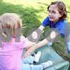 Rob Winner – rwinner@daily-chronicle.com<br /> <br /> Emily Earl (right), 9, catches her sister Alex, 1, as she comes down a slide at their home in DeKalb, Ill. on Thursday April 29, 2010.