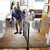 Rob Winner – rwinner@daily-chronicle.com<br /> <br /> Long-time DeKalb resident Ivan Williams, 88, uses a handrail to move up a different level in his home in DeKalb, Ill. on Friday August 20, 2010.