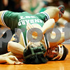 Rob Winner – rwinner@daily-chronicle.com<br /> <br /> Glenbard West's Eh Doh Lwei (top) is held by DeKalb's Jake Jones during their 119-pound quarterfinal match at the Don Flavin Tournament at DeKalb on Wednesday, Dec. 29, 2010.<br /> <br /> **Jones of DK won