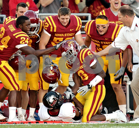 Beck Diefenbach  -  bdiefenbach@daily-chronicle.com<br /> <br /> Northern Illinois corner back Tommy Davis (20, bottom) is taken down by Iowa State's Darius Darks (6) during the first quarter of the game at Jack Trice Stadium on the campus of Iowa State University in Ames, Iowa, on Thursday Sept. 2, 2010. Iowa State defeated Northern Illinois 27 to 10.