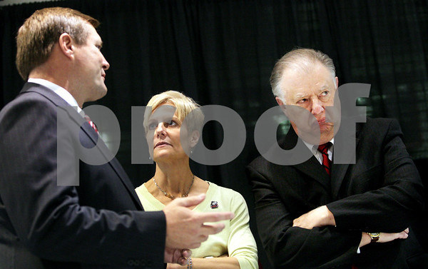 Beck Diefenbach  -  bdiefenbach@daily-chronicle.com<br /> <br /> New women's head coach Kathi Bennett (center) talks with Northern Illinois athletic director Jeff Compher (left) and president John Peters before her introduction at the NIU Convocation Center in DeKalb, Ill., on Tuesday May 18, 2010.