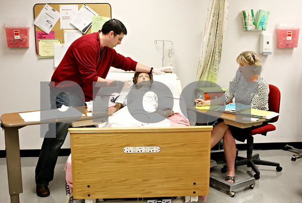 Rob Winner – rwinner@daily-chronicle.com<br /> <br /> Kishwaukee College student John Brandmeyer is tested in a nursing lab at the college by instructor Kay Singer on Thursday October 14, 2010 in Malta, Ill.