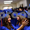 Beck Diefenbach  -  bdiefenbach@daily-chronicle.com<br /> <br /> Genoa-Kingston High School senior Michelle Golon checks the hat and hair of classmate Katie Hanson before entering the graduation ceremony with the rest of their class at G-K High School in Genoa, Ill., on Tuesday May 18, 2010.