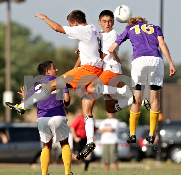 Beck Diefenbach - bdiefenbach@daily-chronicle.com<br /> <br /> DeKalb's Joe Ferguson (8, left) and Hononegah Jayd Meyers (16, right) sandwich DeKalb's Anthony Vivero (10) as they all attempt to head the ball during the first half of the game at DeKalb High School in DeKalb, Ill., on Tuesday Aug. 24, 2010. DeKalb and Hononegah tied 1 to 1.