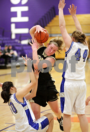 Beck Diefenbach  -  bdiefenbach@daily-chronicle.com<br /> <br /> Sycamore's Jessica Pluhm (30) grabs a loose ball during the first quarter of the IHSA Class 3A Regional playoff game against Burlington Central High School at Rochelle Township High School in Rochelle, Ill, on Monday Feb. 15, 2010.