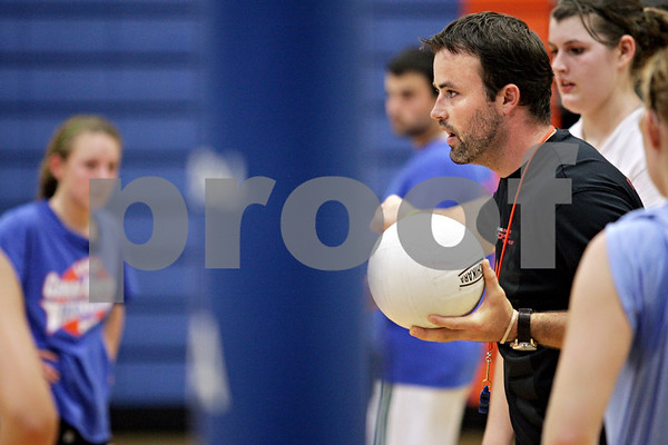 Beck Diefenbach - bdiefenbach@daily-chronicle.com<br /> <br /> New head coach Keith Foster directs his players during practice at Genoa-Kingston High School in Genoa, Ill., on Thursday Aug. 19, 2010.