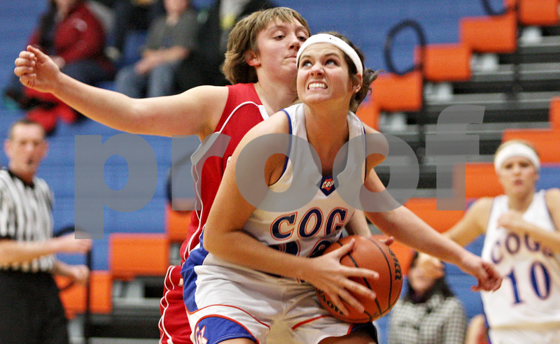 Rob Winner – rwinner@daily-chronicle.com<br /> <br /> Genoa-Kingston guard Karlie Fisher (front) moves past South Beloit defender Abbie Stevens during the first quarter in Genoa on Monday night. Genoa-Kingston defeated South Beloit 72-27.