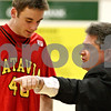 Rob Winner – rwinner@daily-chronicle.com<br /> Batavia's Levi Maxey listens to coach Jim Roberts instruction during the first quarter of their game at Sycamore. Batavia defeated Sycamore, 68-63.