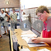 Beck Diefenbach  -  bdiefenbach@daily-chronicle.com<br /> <br /> Brennan Reeder, a Northern Illinois University student from Mendota, fills out his tax forms in the DeKalb Post Office in DeKalb, Ill., on Wednesday April 14, 2010. With the help of his uncle, Reeder did his taxes in the last few weeks but waited until Wednesday to mail them.