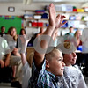 Rob Winner  -  rwinner@daily-chronicle.com<br /> <br /> Bradford Edwards, 8, raises his hand as third grade teacher Katie Algrim (not pictured) plays a game with her new students and their parents during the first day of school at West Elementary School in Sycamore, Ill. on Wednesday August 25, 2010.