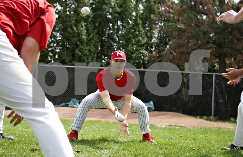 "Rob Winner – rwinner@daily-chronicle.com<br /> <br /> Pitcher Tony Manville plays a game called ""two ball"" with his teammates before the start of NIU baseball practice on Thursday April 1, 2010 in DeKalb, Ill."