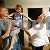 Rob Winner – rwinner@daily-chronicle.com<br /> <br /> The Rozek family, which includes John (from left to right), Andreana, 7, Heather and Dameian, 5, spend some quality time together at their home before dinner on Thursday April 7, 2010 in Sandwich, Ill. Heather and her husband, John, are both out of work and have experienced their share of economic and health care-related hardships over the last year.