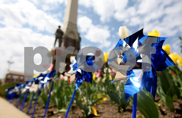 Rob Winner – rwinner@rwinner@daily-chronicle.com<br /> <br /> Pinwheels were placed around the flower garden in front of the DeKalb County Courthouse  in Sycamore, Ill. for Hands Around the Courthouse on Thursday April 29, 2010. The pinwheels stood for turning change.
