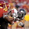 Beck Diefenbach  -  bdiefenbach@daily-chronicle.com<br /> <br /> Northern Illinois's Tommy Davis (20, right) is tackled by Iowa State's Matt Morton (39) during the first quarter of the game at Jack Trice Stadium on the campus of Iowa State University in Ames, Iowa, on Thursday Sept. 2, 2010.