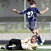 Rob Winner – rwinner@daily-chronicle.com<br /> <br /> Sycamore's Sarah Fischer (bottom) makes a save on Saint Viator's Taylor Skala during the first half of the IHSA Class 2A Barrington Super-Sectional on Tuesday June 1, 2010 in Barrington, Ill. Saint Viator defeated Sycamore, 3-0.