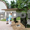Rob Winner – rwinner@daily-chronicle.com<br /> <br /> On the afternoon of Friday June 25, 2010, Joe and Jean Bjorn, residents of Sycamore, visited the Dee Palmer statue near the band shell in Hopkins Park in DeKalb, Ill. This year marks the 75th year of the DeKalb Park District.