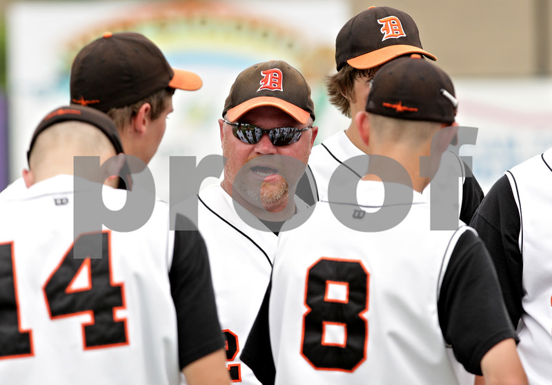 Beck Diefenbach  -  bdiefenbach@daily-chronicle.com<br /> <br /> DeKalb head coach Justin Keck (center) talks with his players after Brian Sisler and Jake Gordon collided during the first inning of the IHSA Class 3A State Semifinal Game against Marian Central in Joliet, Ill., on Friday June 11, 2010.