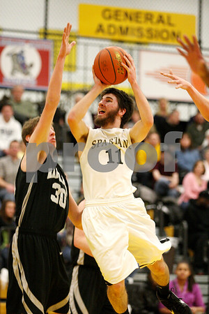 Rob Winner – rwinner@daily-chronicle.com<br /> Sycamore's Luke Johnson looks to take a jump shot in the second quarter.