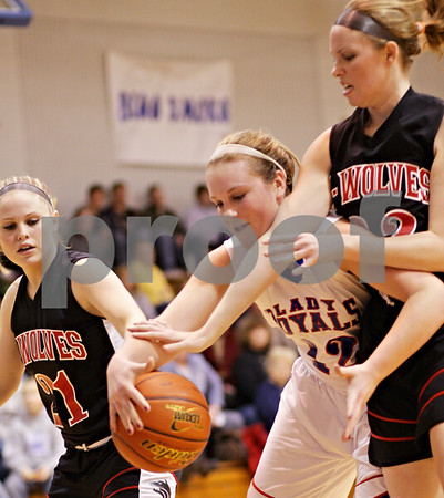 Beck Diefenbach  -  bdiefenbach@daily-chronicle.com<br /> <br /> Hinckley-Big Rock's Katie Hollis (12, center) and Indian Creek's Gretchen Tyler (21, left) and Vicki Novotny (32, right) reach for a loose ball during the second half of the Little 10 Tournament semi-final game at H-BR in Hinckley, Ill., on Thursday Jan. 21, 2010. H-BR defeated Indian Creek 69 to 34.