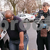 Beck Diefenbach  -  bdiefenbach@daily-chronicle.com<br /> <br /> Using a Care Trak radio telemetry-based locator, DeKalb County Sheriff Roger Scott, right, and deputy Van Bomar train to find a missing person outside the county administration building in Sycamore, Ill., on Thursday March 11, 2010. The Care Trak system is meant to track individuals at risk with wandering.
