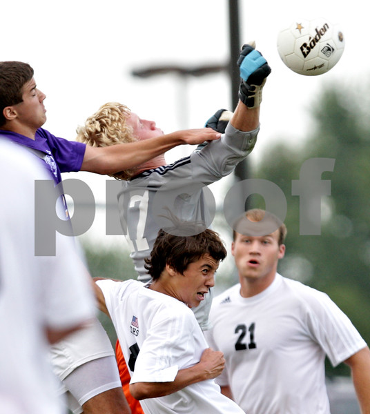 Beck Diefenbach - bdiefenbach@daily-chronicle.com<br /> <br /> DeKalb goal keeper Cully Hicks (top center) punches the ball away during the first half of the game at DeKalb High School in DeKalb, Ill., on Tuesday Aug. 24, 2010. DeKalb and Hononegah tied 1 to 1.