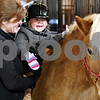 Rob Winner – rwinner@daily-chronicle.com<br /> After a hippotherapy session at Blazing Prairie Stars in Maple Park, Ill., physical therapist Loren Gineris helps hold Maya Townsend, 3 of Geneva, so she could hug Chaves, one of the therapy horses, on Wednesday January 13, 2010.