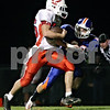 Rob Winner – rwinner@daily-chronicle.com<br /> <br /> Oregon's Connor Skoumal crosses the goal line before Genoa-Kingston's Mitchell Dander touches him during the first quarter of their game in Genoa, Ill. on Friday October 1, 2010.
