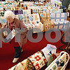 Rob Winner – rwinner@daily-chronicle.com<br /> <br /> Marlyn Montgomery, of Kirkland, takes a look at over 150 quilts on display at the Kirkland Historical Society Quilt Show at United Methodist Church in Kirkland, Ill. on Saturday March 20, 2010.