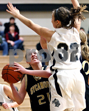 Rob Winner – rwinner@daily-chronicle.com<br /> Sycamore's Kate Binder (left) looks to shoot over Kaneland's Emma Bradford during the second quarter of their game in Maple Park, Ill. on Saturday February 6, 2010. Sycamore defeated Kaneland, 43-39.