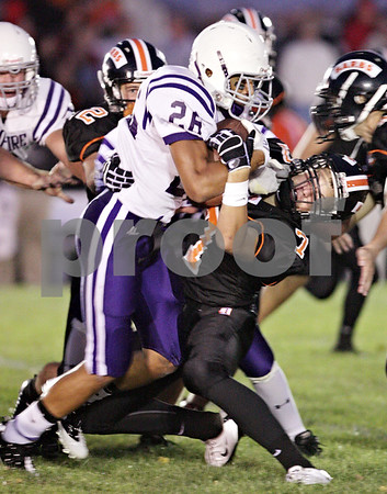 Beck Diefenbach  -  bdiefenbach@daily-chronicle.com<br /> <br /> Hampshire running back Lorenzo Brandon (26) collides with DeKalb linebacker Dan Matya (7) during the first quarter of the game at DeKalb High School in DeKalb, Ill., on Friday Sept. 3, 2010.