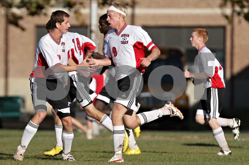 Rob Winner – rwinner@daily-chronicle.com<br /> <br /> David Drendel (left) congratulates Matt Kyler (8) during his first goal in the first half of the regional quarterfinal game against Byron in Waterman, Ill. on Wednesday October 13, 2010. Indian Creek went on to defeat Byron, 2-1, in double overtime.