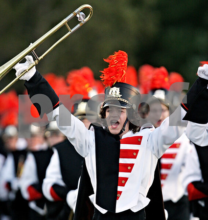 Beck Diefenbach  -  bdiefenbach@daily-chronicle.com<br /> <br /> The DeKalb High School Marching Band enters the field before the start of the football game against Hampshire at DeKalb High School in DeKalb, Ill., on Friday Sept. 3, 2010.