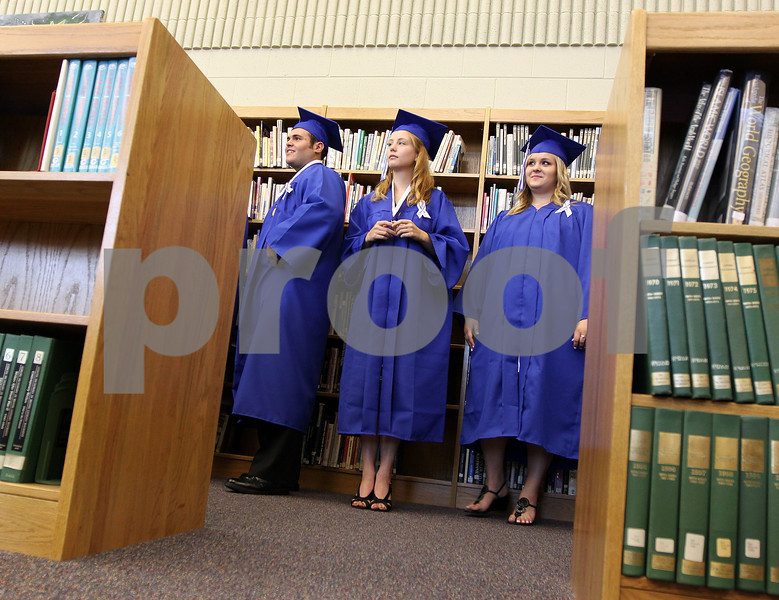 JEFF KRAGE/FOR THE DAILY-CHRONICLE<br /> Hinckey-Big Rock graduate's Ryan Galvan (left), Sarah Freriks (center) and Megan Flannery wait in the library before the start of Sunday's ceremony.<br /> Hinckley 5/30/10