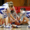 Beck Diefenbach – bdiefenbach@daily-chronicle.com<br /> <br /> Hinckley-Big Rock's Tess Godhardt (left) and Kaitlin Phillips (far right) attempts to steal the ball from Westminster's Sarah Rodgers (center) during the fourth quarter of the IHSA Class 1A Regional playoff game at Indian Creek High School in Shabbona, Ill., on Wednesday Feb. 10, 2010.