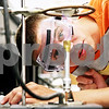 Rob Winner – rwinner@daily-chronicle.com<br /> <br /> Connor Bolander, of Sycamore, checks the flame of a bunsen burner while heating up a crucible filled with magnesium during a chemistry lab at Kishwaukee College in Malta, Ill. on Tuesday June 8, 2010.