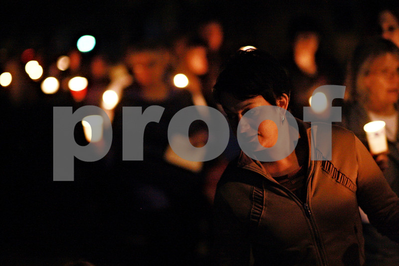 Beck Diefenbach – bdiefenbach@daily-chronicle.com<br /> <br /> Sarah Banbury helps lead the candle light vigil walk after speaking about her experience being assaulted by her husband during Safe Passage's annual vigil at the DeKalb Area Women's Center in DeKalb, Ill., on Monday Oct. 4, 2010.