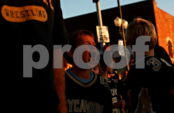 Beck Diefenbach – bdiefenbach@daily-chronicle.com<br /> <br /> Members of the Sycamore youth football team walk down State Street in Sycamore, Ill., on Wednesday September 29, 2010.