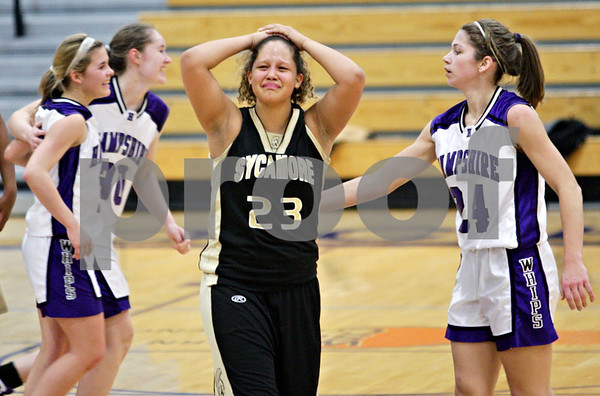 Beck Diefenbach  -  bdiefenbach@daily-chronicle.com<br /> <br /> Sycamore's Jamie Wilson (23) reacts after losing to Hampshire in the IHSA Class 3A Regional game at Rochelle Township High School in Rochelle, Ill., on Wednesday Feb. 17, 2010