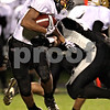 Beck Diefenbach  -  bdiefenbach@daily-chronicle.com<br /> <br /> Sycamore running back Marckie Hayes (1) slips around Kaneland defenders during the first quarter of the class 5A playoff game at Kaneland High School in Maple Park, Ill., on Saturday Oct. 31, 2009.