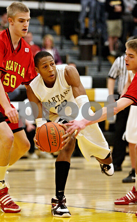 Rob Winner – rwinner@daily-chronicle.com<br /> Sycamore's Sam Ford looks to pass while being pressured by a pair of Batavia defenders during the first quarter. Batavia defeated Sycamore on Friday February 19, 2010 in Sycamore, Ill., 68-63.