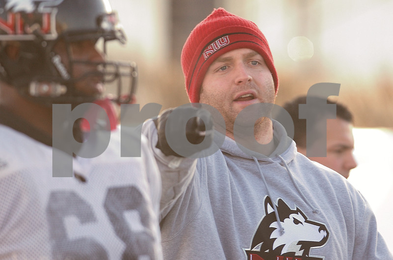 Kyle Bursaw – kbursaw@daily-chronicle.com<br /> <br /> Graduate Assistant Joe Tripodi works with the offensive line at practice on Friday, Dec. 10, 2010.