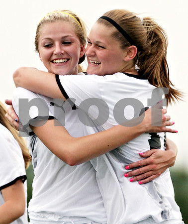 Beck Diefenbach  -  bdiefenbach@daily-chronicle.com<br /> <br /> Sycamore's Rachel Stueber (22, left) is congratulated by Katelyn Brown (11) following Stueber's goal during the first half of the IHSA Class 2A Hampshire Sectional Semi-final game against Rosary at Hampshire High School in Hampshire, Ill., on Tuesday May 25, 2010. Sycamore defeated Rosary 3 to 1.