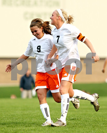 Beck Diefenbach  -  bdiefenbach@daily-chronicle.com<br /> <br /> DeKalb's Alli Smith (9, left) congratulates Lindsey Adshade (7) after Adshade scored a goal during the second half of the game against Plainfield North at DeKalb High School in DeKalb, Ill., on Monday April 12, 2010. Plainfield North defeated Dekalb 4 to 1.