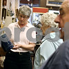Rob Winner – rwinner@daily-chronicle.com<br /> <br /> Ann Tucker (from left), of Sycamore Antiques, shows a pottery piece to Donna Lampkins and her husband Don Lampkins, of Sycamore, on Friday April 23, 2010 in Sycamore, Ill. Sycamore Antiques is a new business that has recently joined the Sycamore Chamber of Commerce.