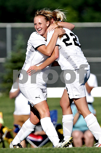 Beck Diefenbach  -  bdiefenbach@daily-chronicle.com<br /> <br /> Sycamore's Lindsey Hemmerich (16, left) congratulates Rachel Stueber (22, right) after Stueber's second goal during the first half of the IHSA Class 2A sectional final game against Freeport at Hampshire High School in Hampshire, Ill., on Friday May 28, 2010.